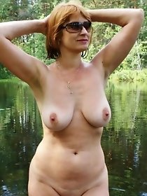 Nude mature bathes in a forest lake
