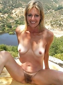 Blonde MILF with wet haired pussy