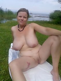 Busty Russian mom resting outdoor