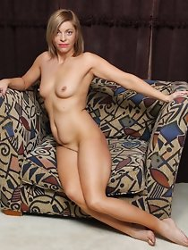 Shaved American babe posing solo