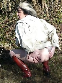 Hot mature pissing in the wood - fetish porn photos