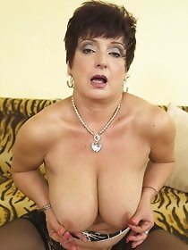 Busty mature wife in porn photo session