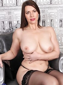 Cute British MILF in dark pantyhose posing on the couch