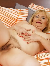 Haired mature lady masturbates with sex toys
