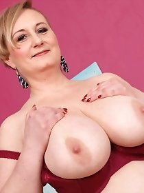 Big titted blonde mature playing with herself