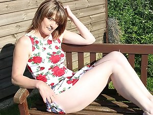 Naughty British mature lady masturbating in the garden