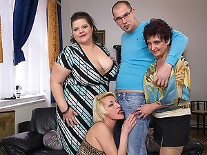 Three mature ladies fucking and sucking a toyboy