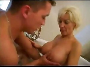 Mommy with fantastic body with young guy