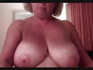 Mature Wipes His Cum off Her Huge Tits, Makes Him Cum Again