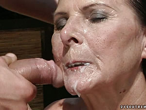 Naughty granny whore rides on young cock